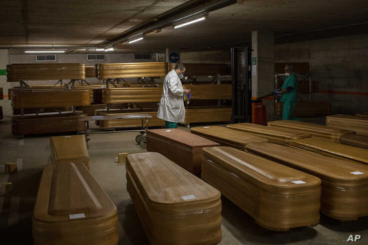 Coffins with the bodies of victims of coronavirus are stored waiting for burial or cremation at the Collserola morgue in…