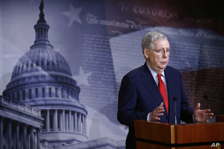 Senate Majority Leader Mitch McConnell of Ky., speaks with reporters after the Senate approved a nearly $500 billion…