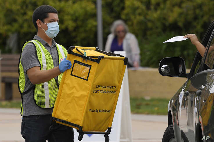 Voters drop off ballots in a special election for California's 25th Congressional District during the coronavirus outbreak,…