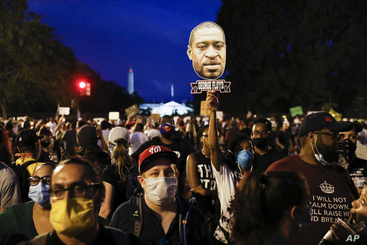 Demonstrators protest Saturday, June 6, 2020, near the White House in Washington, over the death of George Floyd, a black man…