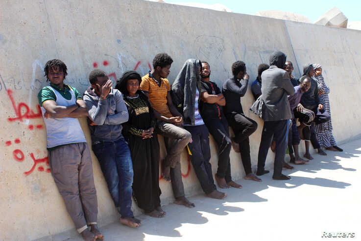 Migrants are seen after they were picked up by a coast guard patrol after a boat accident off the Libyan coast at Qarabulli town, east of the capital Tripoli