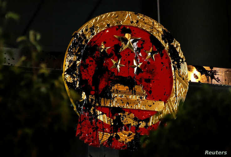 The National Emblem of the People's Republic of China is seen vandalized on the Chinese Liaison Office after a march to call for democratic reforms, in Hong Kong, July 21, 2019.