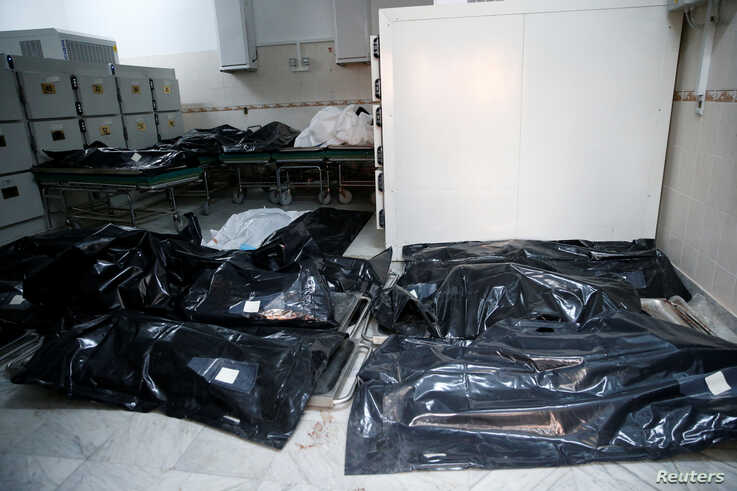 Bags with bodies of migrants who died after an air strike hit a detention center for mainly African migrants in Tajoura are seen in Tripoli Central Hospital