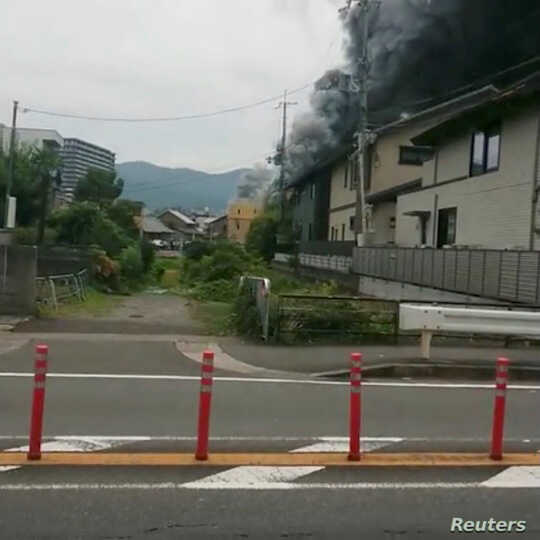 Smoke billows from a fire at the Kyoto Animation studio in Kyoto, Japan, July 18, 2019.
