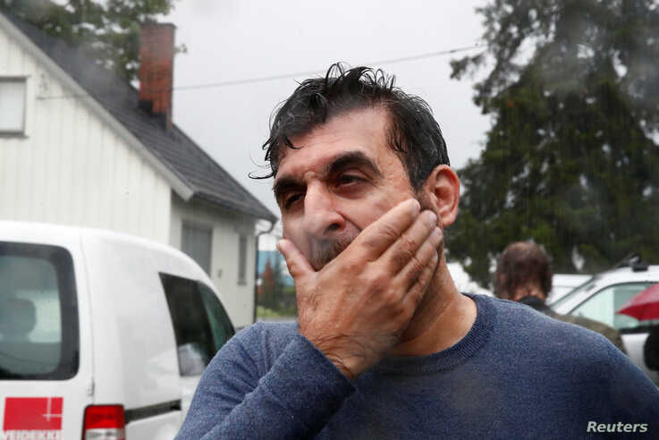 Mosque board member Irfan Mushtaq reacts after a shooting in al-Noor Islamic center mosque, near Oslo, Norway, Aug. 10, 2019.