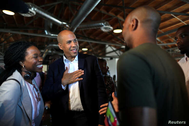 U.S. Senator and Democratic presidential candidate Cory Booker (C) talks to a supporter after speaking at a Gun Violence Prevention roundtable in Los Angeles, California, U.S., August 22, 2019. REUTERS/Lucy Nicholson