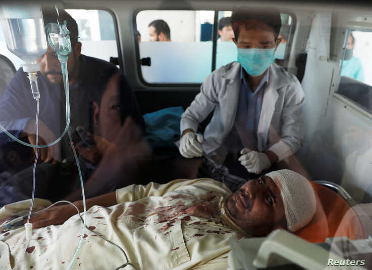 An injured man receives treatment inside an ambulance at a hospital after a blast in Kabul, Afghanistan, Aug. 7, 2019.