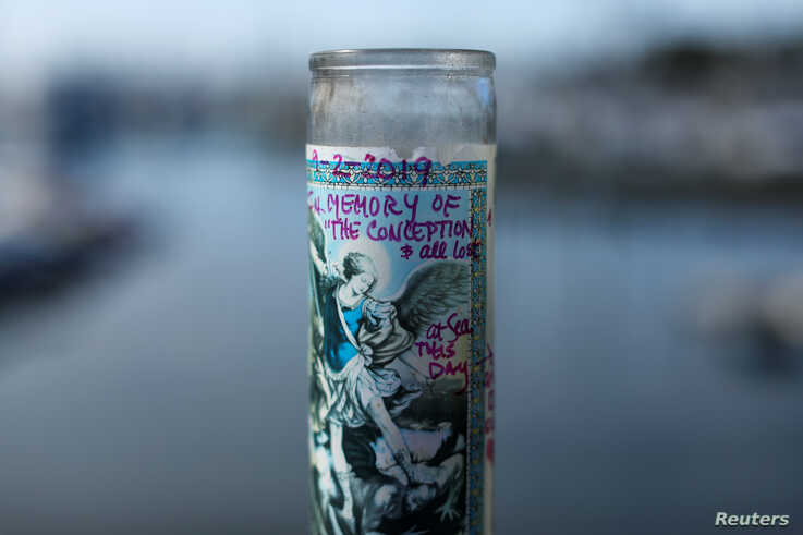 A candle in memory of the Conception and all lost sits at a makeshift memorial near Truth Aquatics as the search continues for those missing in a pre-dawn fire that sank a commercial diving boat near Santa Barbara, California, U.S., September 3, 2019.      REUTERS/Mike Blake