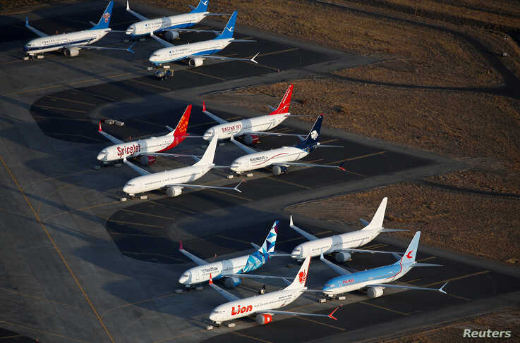 FILE PHOTO: An aerial photo shows Boeing 737 MAX aircraft at Boeing facilities at the Grant County International Airport in…