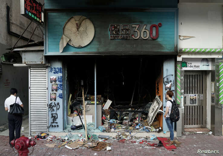 A man inspects a Bestmart store which was vandalised during Sunday's anti-government protest in Hong Kong, China, October 21,…