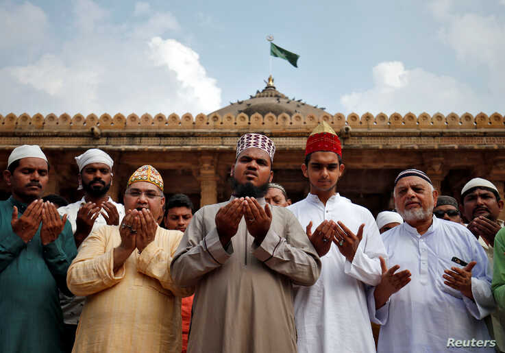 Muslims pray for peace ahead of verdict on a disputed religious site in Ayodhya, inside a mosque premises in Ahmedabad, India,…
