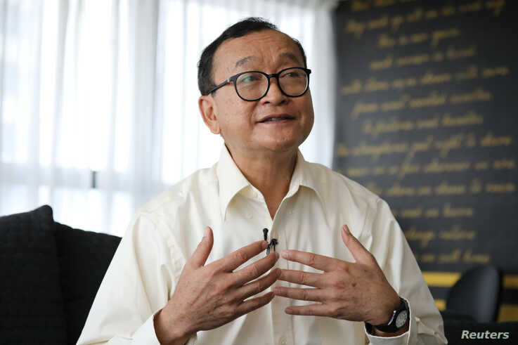 Self-exiled Cambodian opposition party founder Sam Rainsy speaks during an interview with Reuters at a hotel in Kuala Lumpur,…
