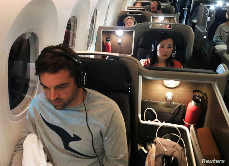 Passengers are seen on board Qantas flight QF7879, flying direct from London to Sydney, November 14, 2019. Picture taken…