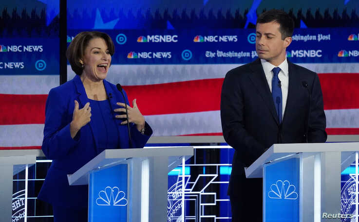 Democratic presidential candidate Senator Amy Klobuchar speaks as South Bend Mayor Pete Buttigieg listens during the fifth 2020…