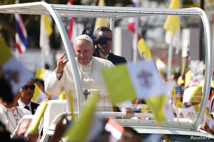 Pope Francis waves to the crowd following his visit to St. Peter's Parish church in the Sam Phran district of Nakhon Pathom…