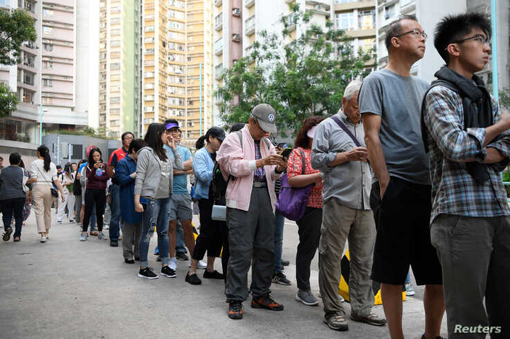 People line up to vote in district council elections in South Horizons in Hong Kong, China November 23, 2019. REUTERS/Laurel…