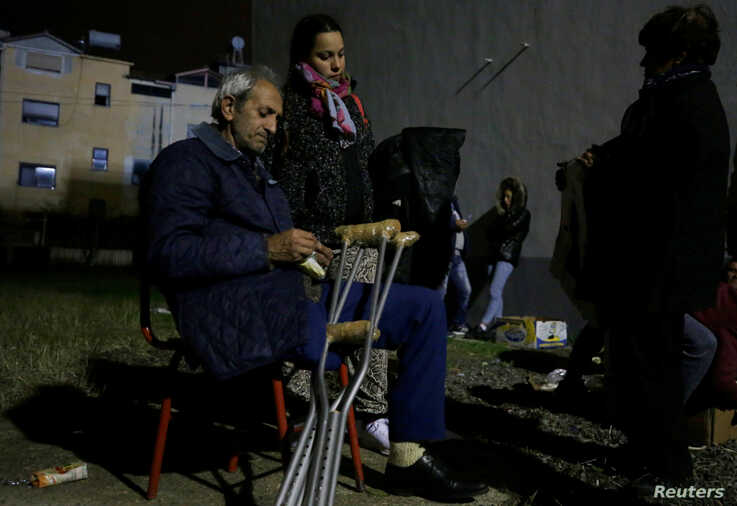 Damnified sit at a makeshift camp in Durres, after an earthquake shook Albania, November 28, 2019. REUTERS/Florion Goga
