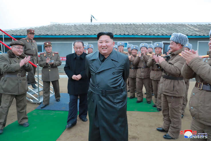 North Korean leader Kim Jong Un oversees a super-large multiple launch rocket system test in this undated picture released by…
