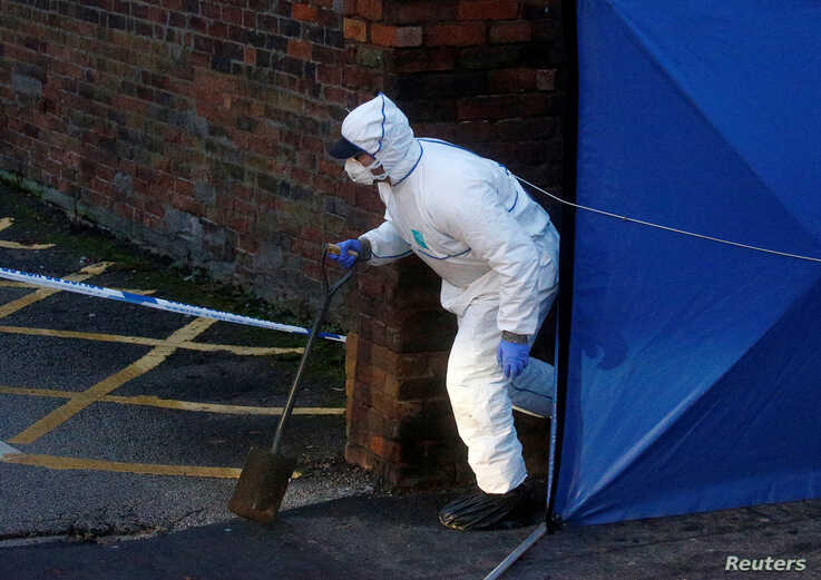 A forensic officer walks outside a property, which is being searched in connection with yesterday's stabbing on London Bridge,…