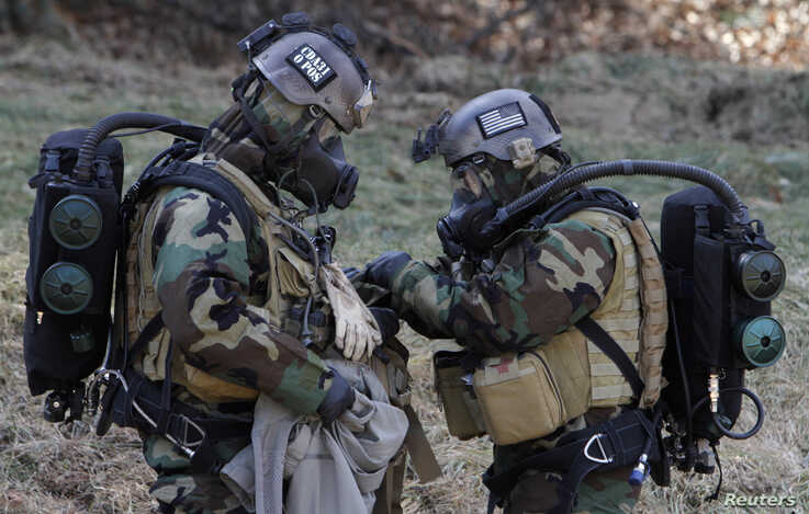 Soldiers from the 2nd Infantry Division of the U.S. attend a military drill for chemical, biological, radiological, and nuclear…