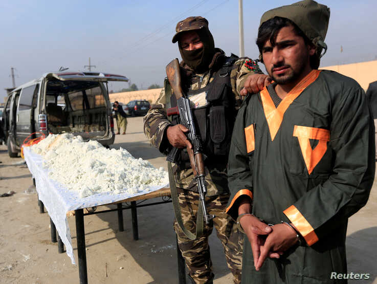 A captured Taliban insurgent is presented to the media after he was detained with car explosive devices in Jalalabad,…