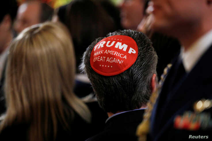 "A participant wears a Trump ""Make America Great Again"" yarmulke as they attend a White House Hanukkah reception where U.S…"