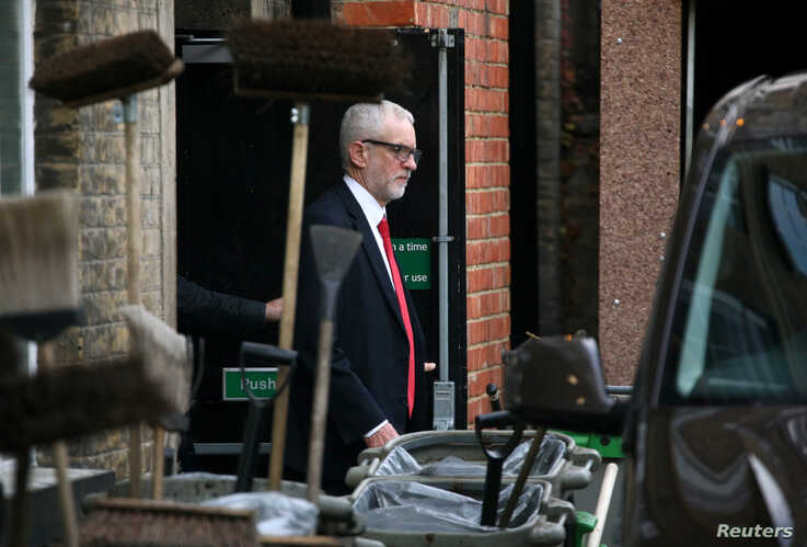 Britain's opposition Labour Party leader Jeremy Corbyn leaves Islington Town Hall through the backdoor after a meeting…