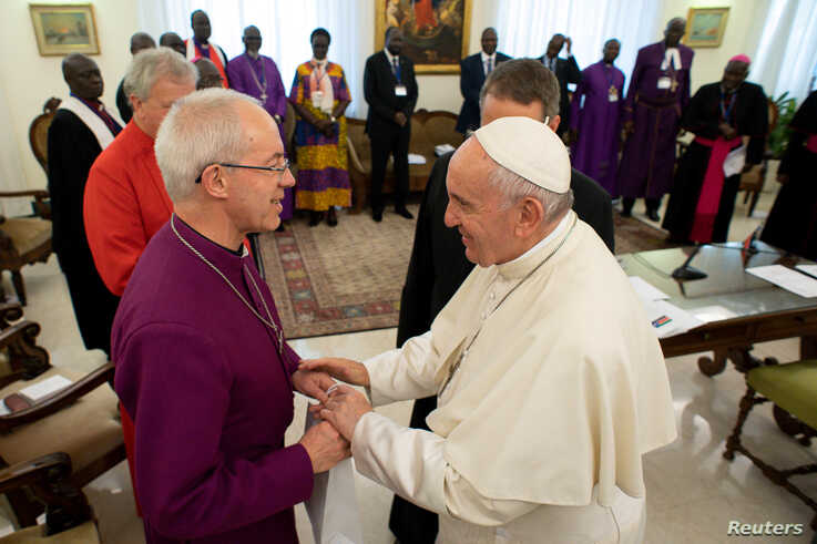 FILE PHOTO: Pope Francis meets the Archbishop of Canterbury Justin Welby at the end of a two day Spiritual retreat with South…