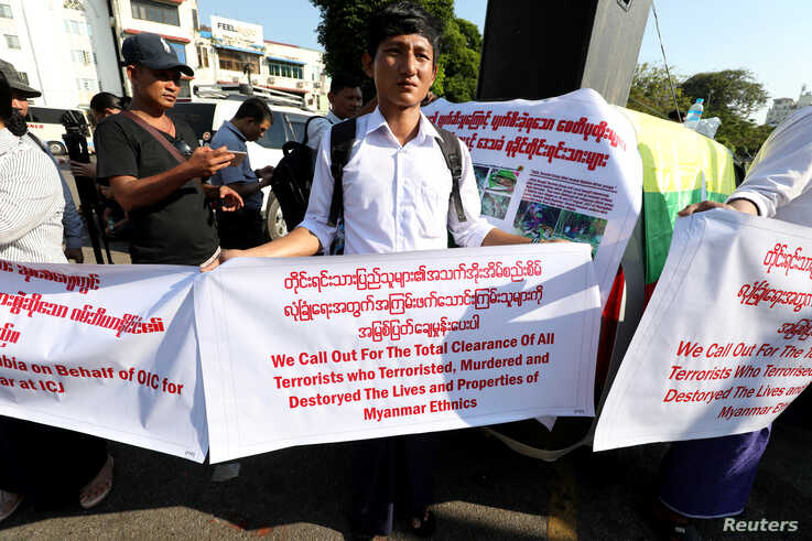 Myanmar nationalist group gather to protest against Gambia and Organisation of Islamic Cooperation (OIC) for accusing Myanmar…