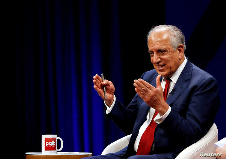 FILE PHOTO: U.S. envoy for peace in Afghanistan Zalmay Khalilzad speaks during a debate at Tolo TV channel in Kabul,…