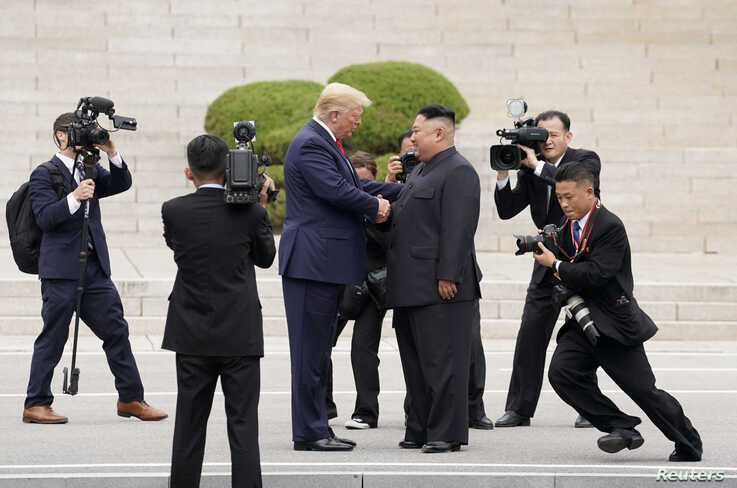U.S. President Donald Trump meets with North Korean leader Kim Jong Un at the demilitarized zone separating the two Koreas, in…