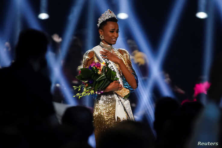 Zozibini Tunzi, of South Africa, takes her first walk as Miss Universe after winning the 2019 Miss Universe pageant at Tyler…