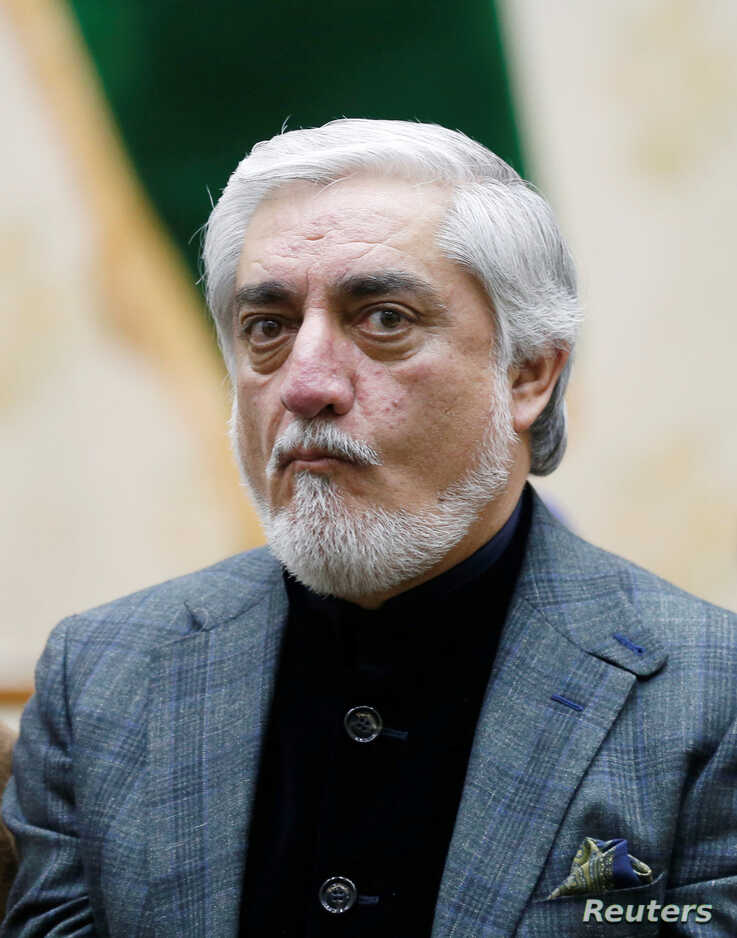 Afghanistan's presidential candidate Abdullah Abdullah arrives for a news conference after the preliminary presidential…