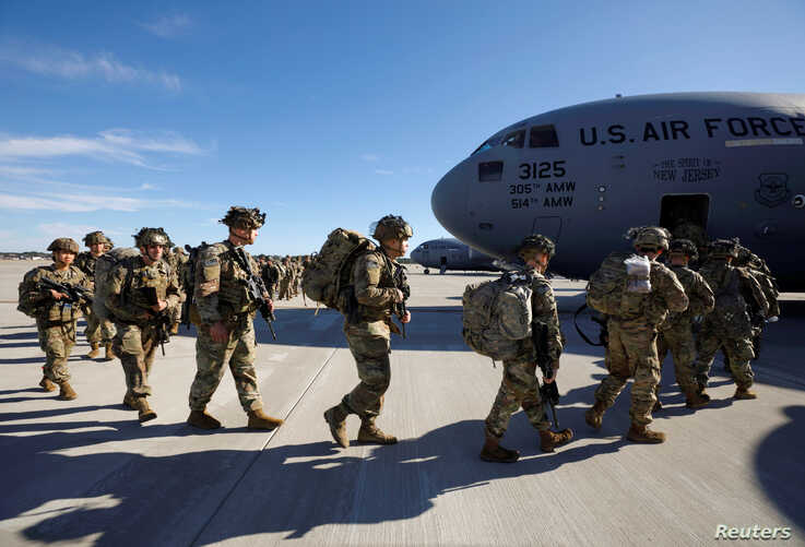 U.S. Army paratroopers of an immediate reaction force from the 2nd Battalion, 504th Parachute Infantry Regiment, 1st Brigade…