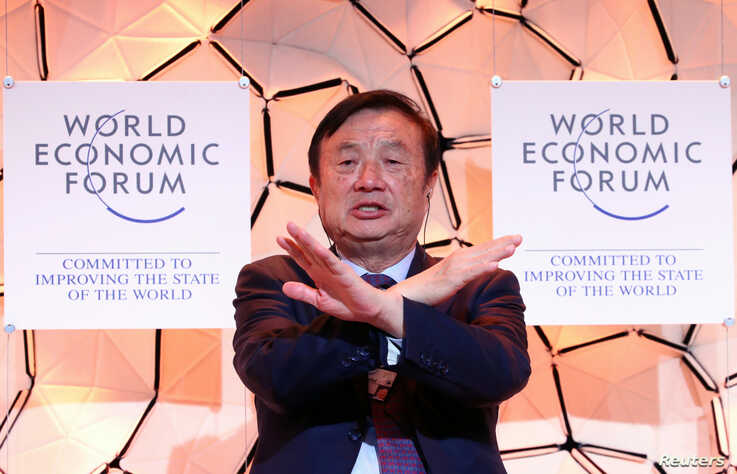 Ren Zhengfei, Founder and Chief Executive Officer of Huawei Technologies gestures during a session at the 50th World Economic…