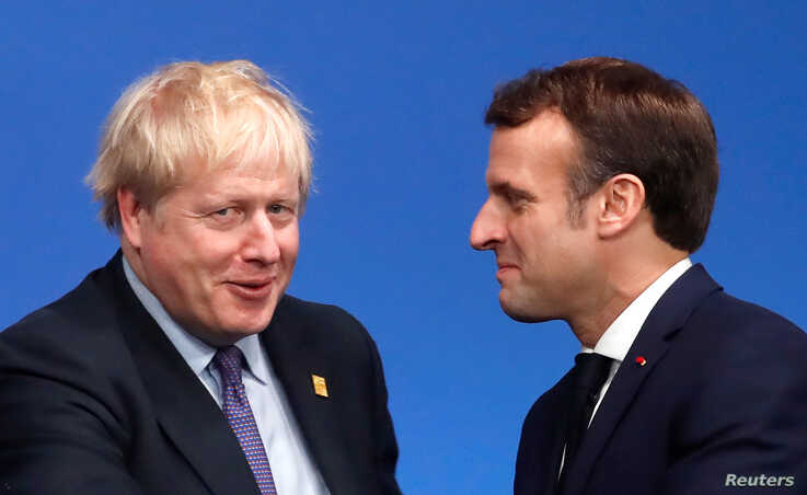 Britain's Prime Minister Boris Johnson welcomes France's President Emmanuel Macron at the NATO leaders summit in Watford,…