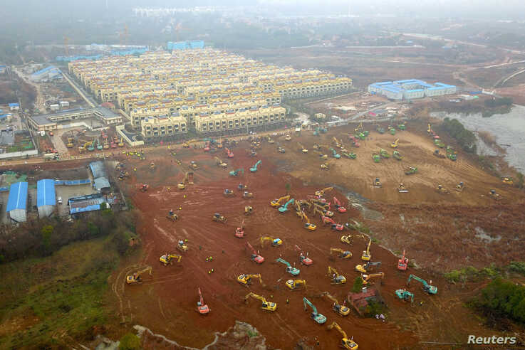 Excavators and bulldozers are seen at the construction site where the new hospital is being built to treat patients of a new…