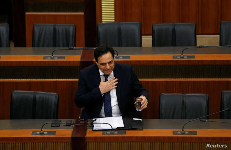 Lebanon's Prime Minister Hassan Diab attends a parliament session at the parliament building in downtown Beirut, Lebanon…