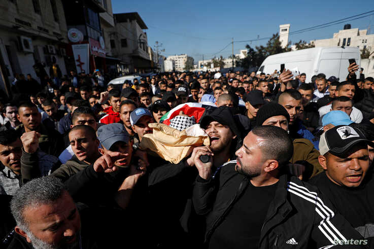SENSITIVE MATERIAL. THIS IMAGE MAY OFFEND OR DISTURB  Mourners carry the body of Palestinian Yazan Abu Tabekh, who was killed…
