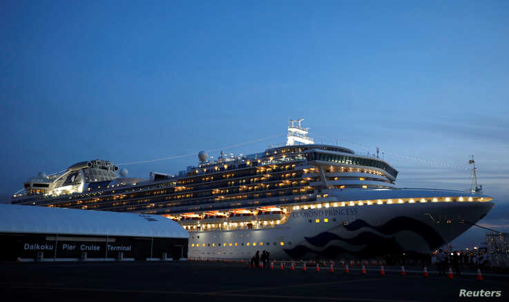 The cruise ship Diamond Princess, where 10 more people were tested positive for coronavirus on Thursday, is seen at Daikoku…