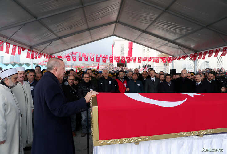 Turkey's President Tayyip Erdogan speaks during funeral ceremony of Turkish soldier Emre Baysal who was killed in Syria's Idlib…