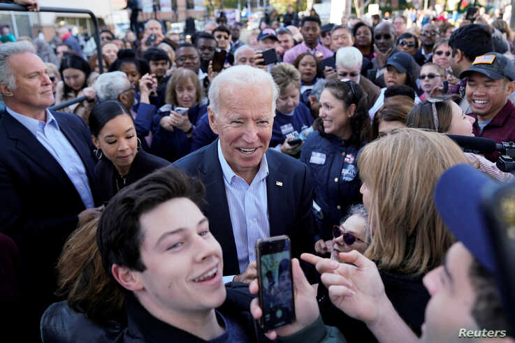 "Democratic presidential candidate and former Vice President Joe Biden takes selfies with supporters at a ""Get out the Vote""…"