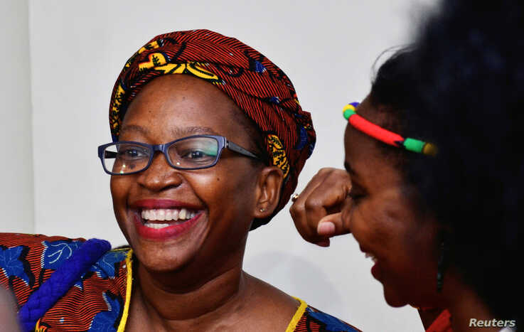 Ugandan prominent academic Stella Nyanzi reacts after the court quashed her conviction and jail term, in Kampala, Uganda…