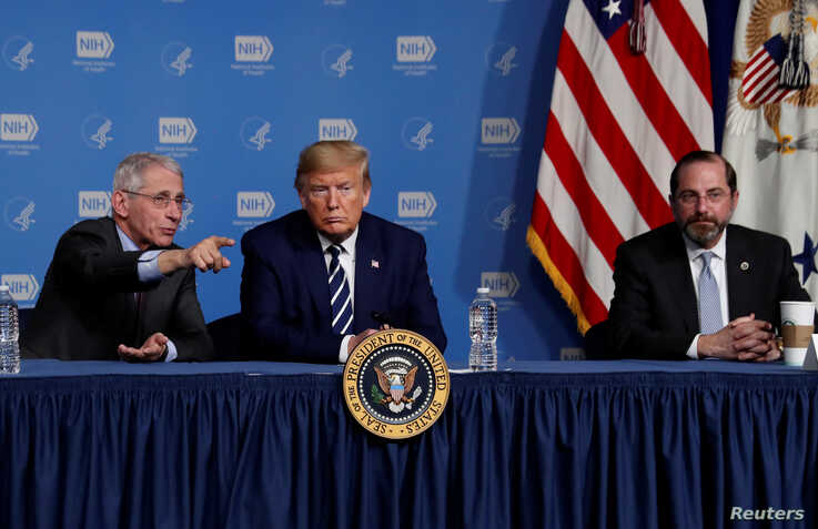 U.S. President Donald Trump is flanked by Anthony Fauci, director of the NIH National Institute of Allergy and Infectious…