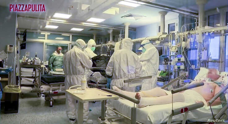 Medical staff in protective suits treat coronavirus patients in an intensive care unit at the Cremona hospital in northern…