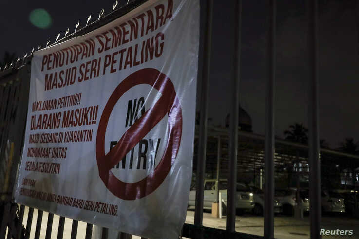 "A ""No Entry"" sign is seen outside Seri Petaling Mosque, which has emerged as a source of hundreds of new coronavirus disease…"