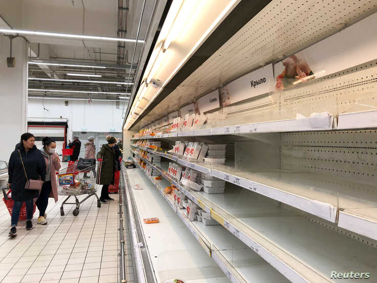 A view shows empty shelves in the meat department of a supermarket amid coronavirus disease (COVID-19) concerns in Moscow,…