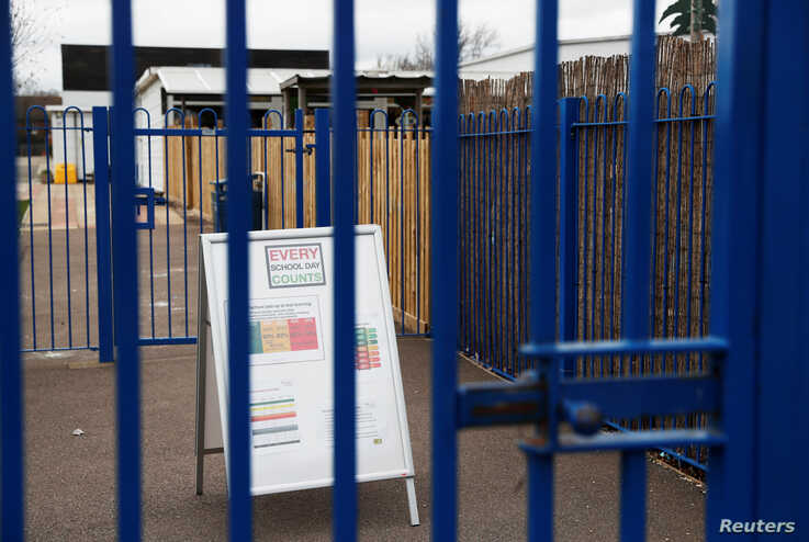 General view of a sign outside the Parkside Community Primary School in Borehamwood as the spread of the coronavirus disease …