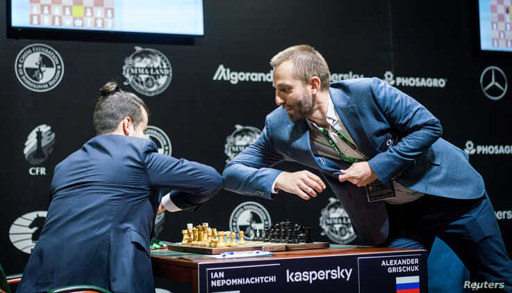 Russian chess player Alexander Grischuk smells hand sanitiser as he takes part in the Candidates Tournament, organised by the…