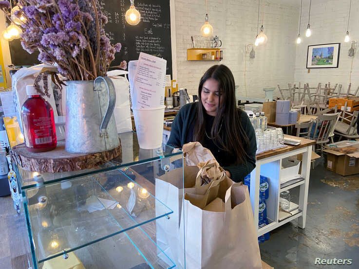 London Cafe owner Amira Gajia shuts down her cafe in Hackney to volunteer her services to the NHS, one of over 400,000 people…